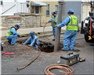 Public Works Employees Doing Plumbing Work
