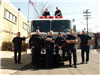 Members of Fire Department Standing in Front of Fire Truck