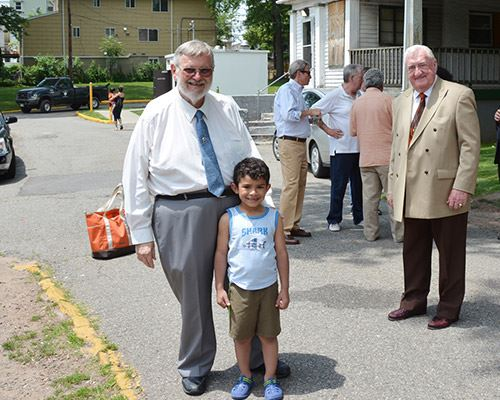 Mayor Standing With Little Boy